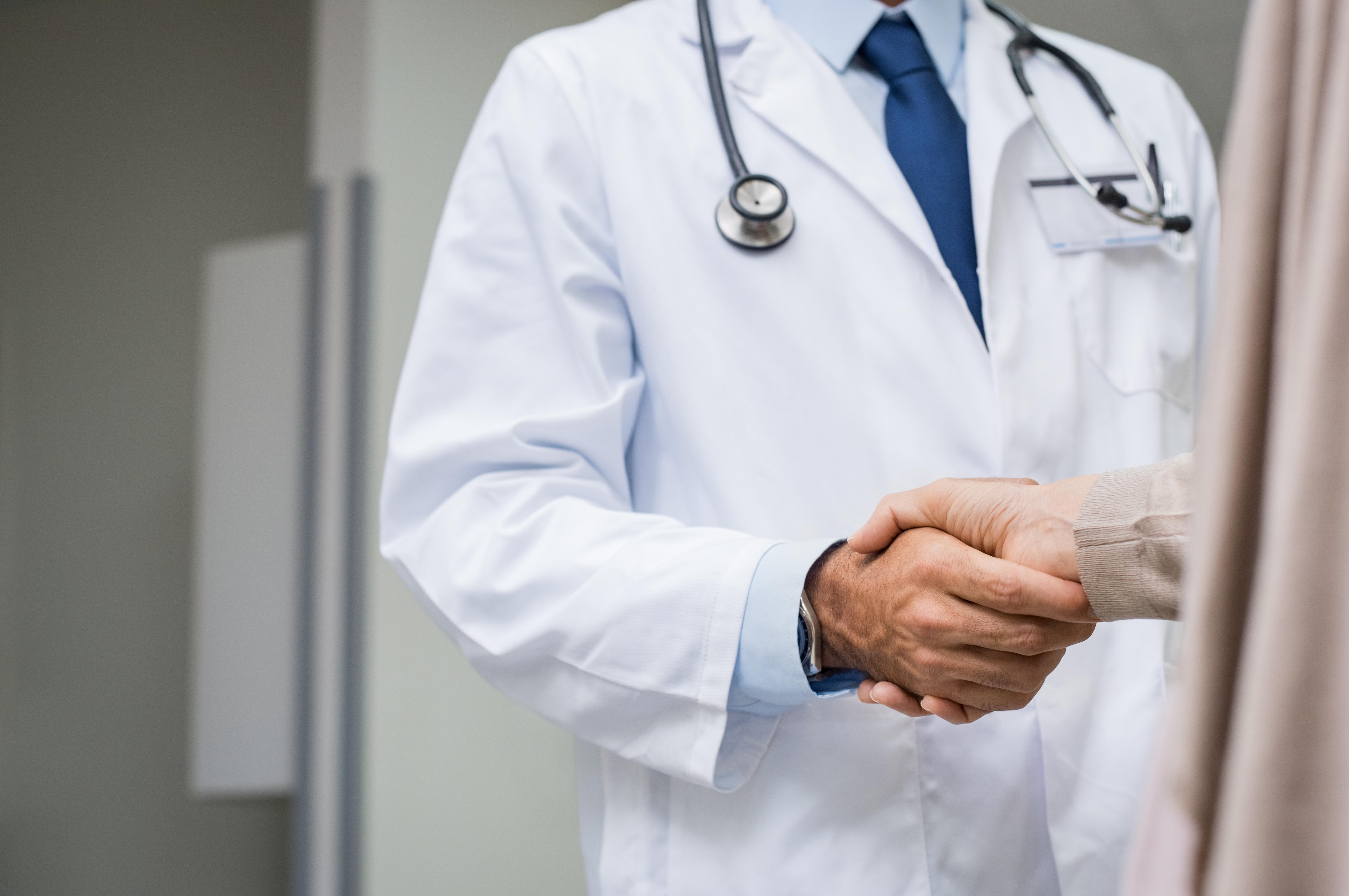 Doctor patient handshake